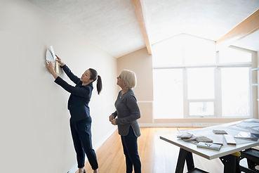 Two women choosing wall colours