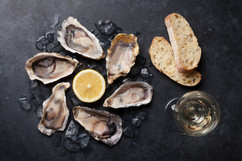 Opened oysters, ice and lemon with white