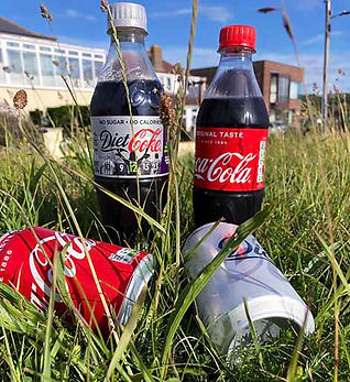 Coke products in grass