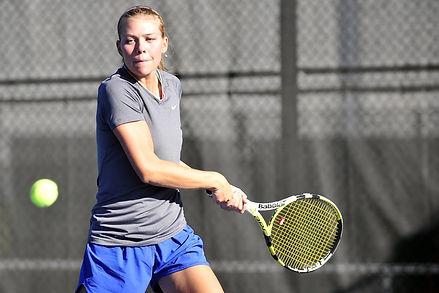 Tennis player woman hitting ball.jpg