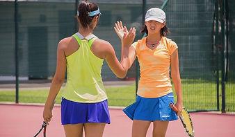 Active Tennis Coaching || Tennis Girs playing on court high fiving