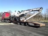 Transport maszyny przeładunkowej Terex-Fuchs (wymiary ładunku: 9,20 x 2,70 x 3,49m waga: 27,0t)