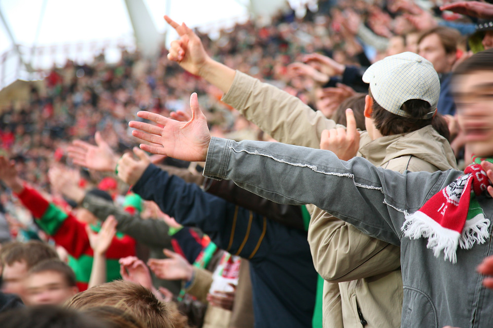 Yelling causes excessive voice strain at sporting events, especially in the colder months