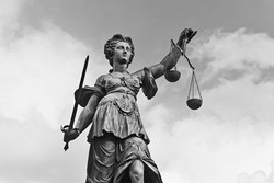 bigstock-Statue-of-Justice-with-sword-a-71768824 smaller_edited