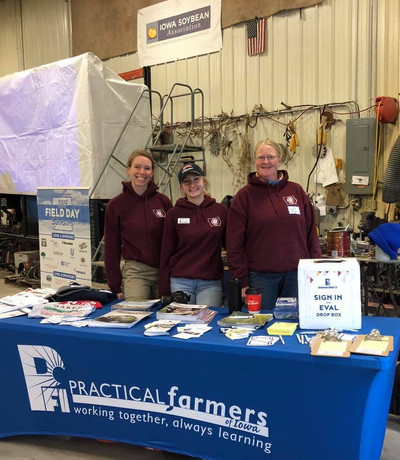 Janelle and AmeriCorps Green Iowa members working with Practical Farmers of Iowa.