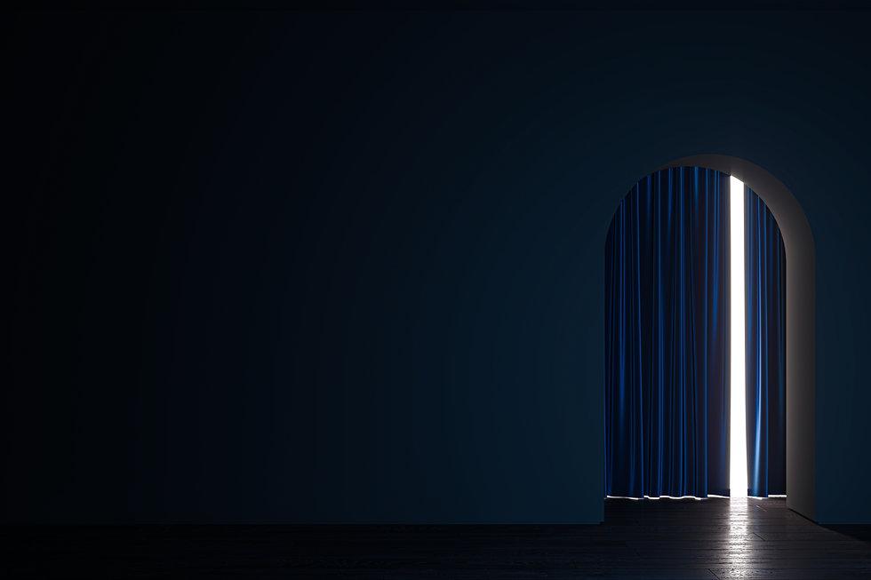 Light gets into a dark room through the curtain