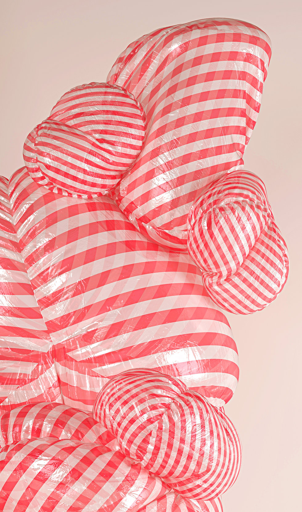 Closeup of blown up red-white stripes amorphic shapes made of transparent plastic