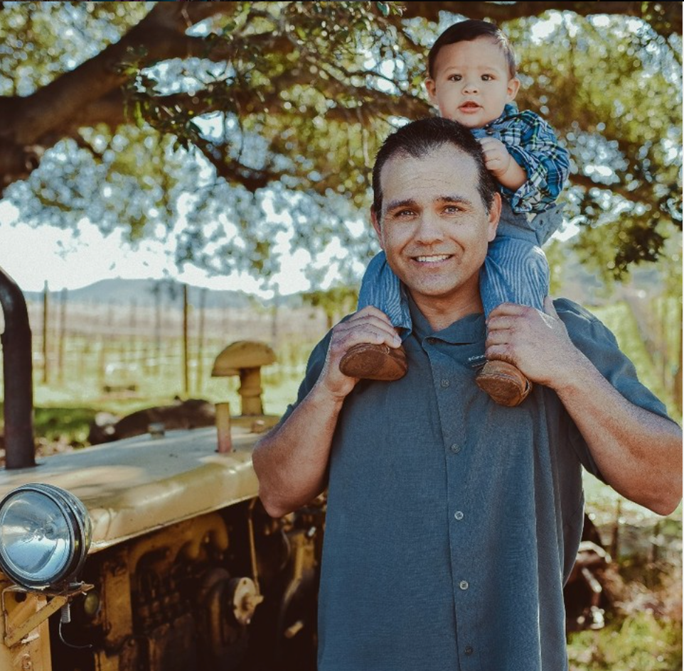 Vineyard manager Nathan Malagon and son of Mina Penélope - as inspirational giving shoulder rides as he is when listening to and tending the vines.