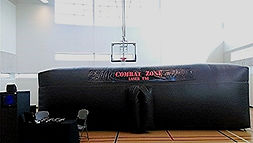The Combat Zone is an inflatable maze with twists and turns that will confuse you and special effect lighting that will daze you.     A slight haze fills the air allowing you to see your laser beams, but beware because someone may be lurking in the hazy mist. You must stay alert at all times even as the sounds of guns firing, grenades exploding and women screaming surround you. The moment you let your guard down your enemy will attack!!