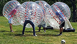 BUBBLE SOCCER is, for the most part, exactly what it sounds like: full-contact soccer where each player wears a plastic bubble from thigh to head approximately five feet in diameter.  The bubble itself is a souped-up version of those inflatable sumo wrestling costumes, although your hands remain inside the bubble at all times.  The bubbles let players bounce around with the ball and knock each other to the ground without getting hurt.  Now, we have a game that is safe, entertaining to watch, and hilariously fun to play.  It's a game that is a combination of soccer, human bowling, pillow fighting, and sumo wrestling.