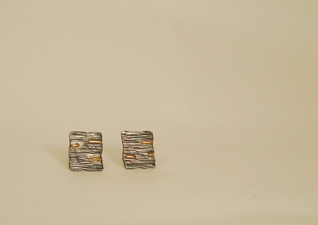 tectonic oxidised square plaques with gold