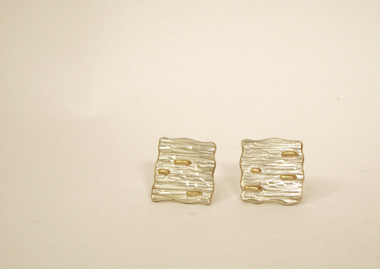 tectonic square plaques with gold