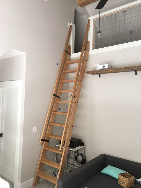 Loft ladder of fir and black steel details