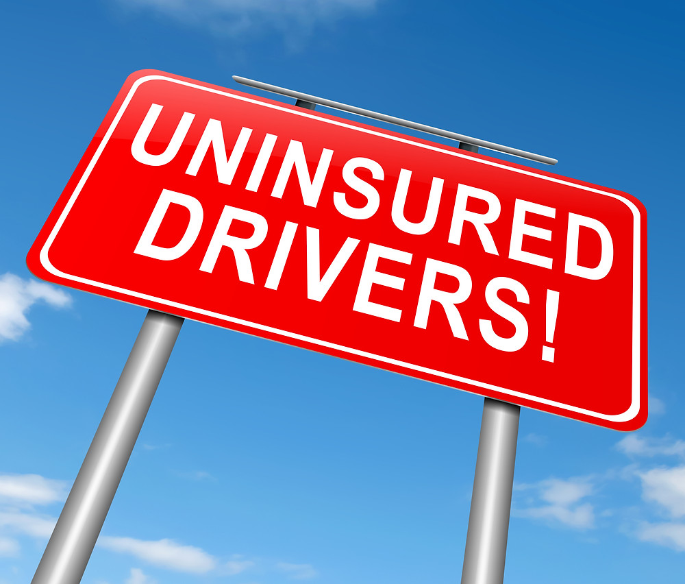 Red Sign showing uninsured drivers in Florida rising