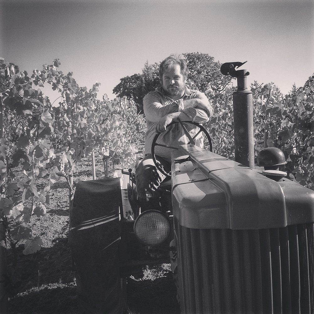 Joey Myers viticulturalist on his tractor