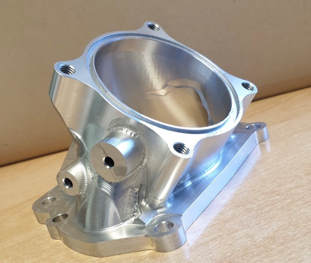Housing to connect throttle body to supercharger