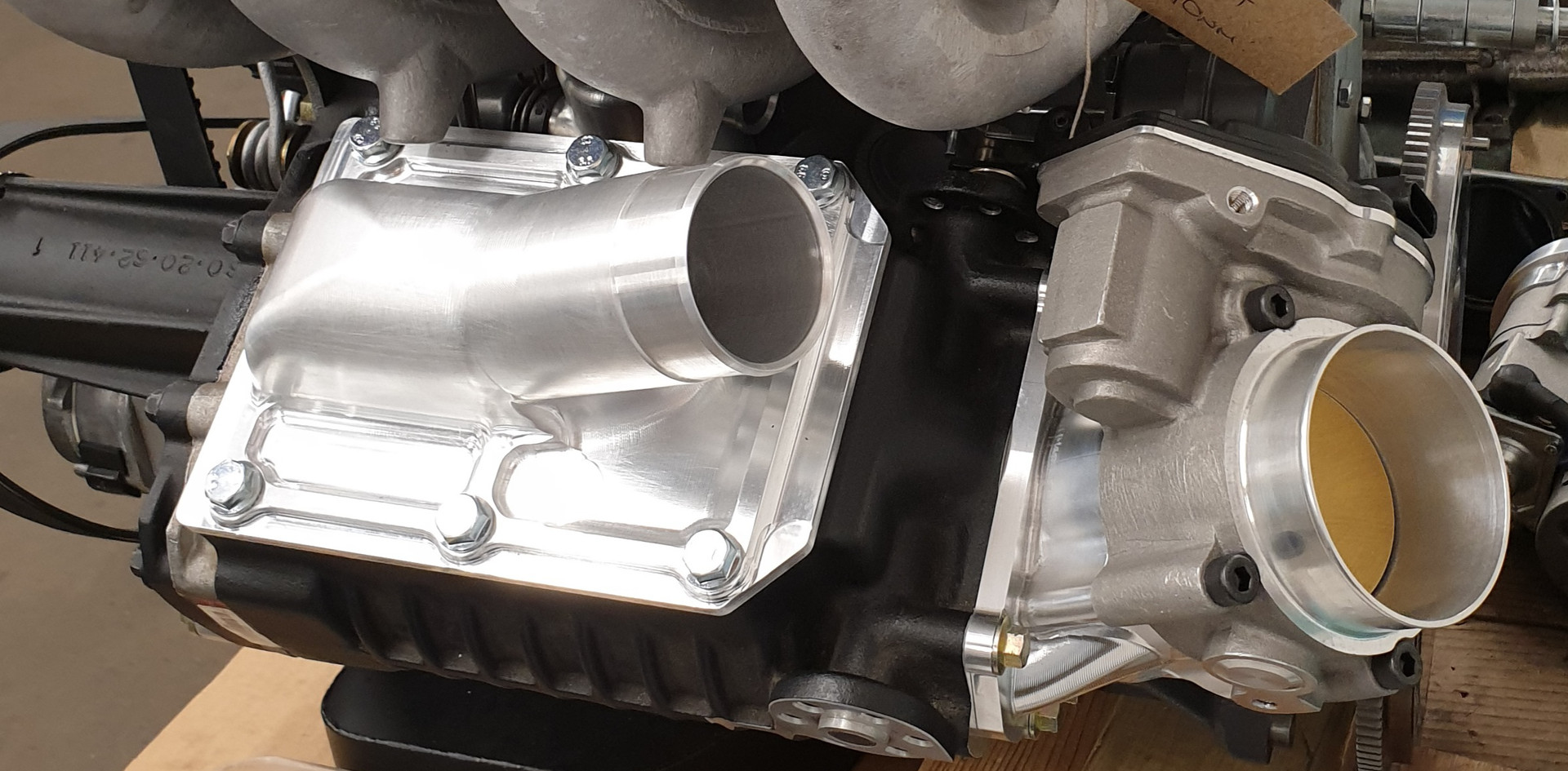 Supercharger assembled with inlet and outlet developed parts