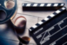 28047175-movie-clapper-and-film-reel-on-