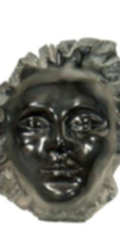 Tête souriante et sereine en marbre noir de Belgique poli et brillant