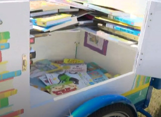 """Muskegon Heights' """"Book-Bike"""" encourages summer reading"""