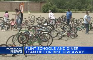 Flint Community Schools and local diner sponsor bike giveaway