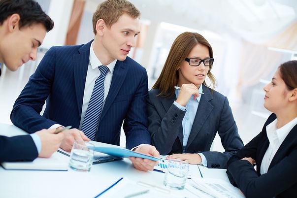 male-executive-holding-blue-folder-meeti
