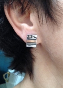 Wearing my continuous strata studs.  £89