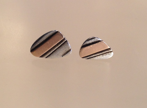 Layered Sterling silver and gold studs.  £69