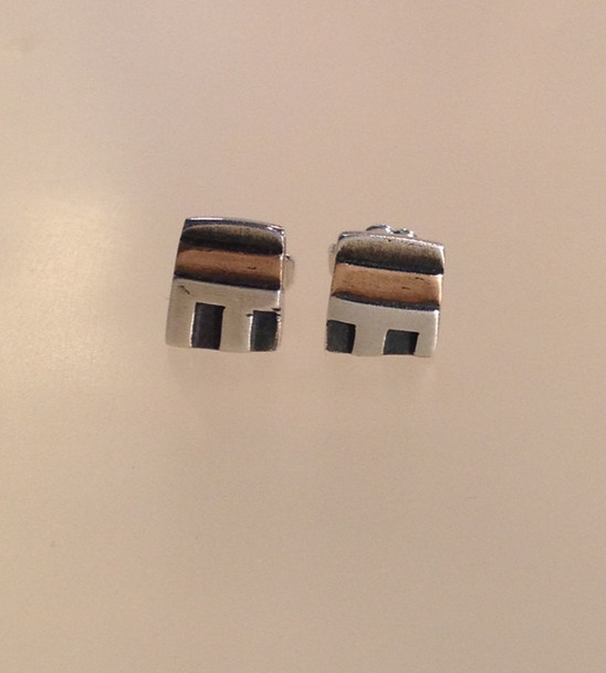 Small house, silver and gold studs.  £59