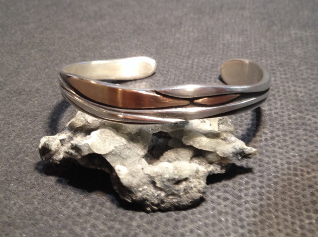 Sterling silver and 18ct rose gold cuff.  £325