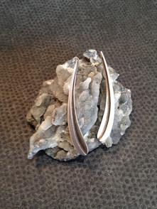 Slender curve earrings.  £89