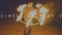 circle of play man spins hula hoop with fire