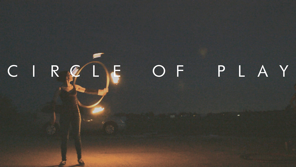 circle of play girl spins hula hoop with fire