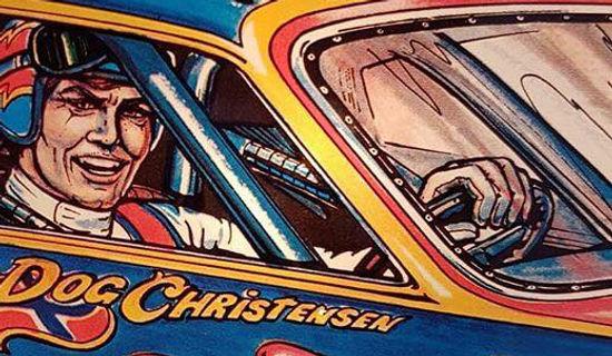 Bally 1980 Nitro Ground Shaker pinball machine close up of backglass driver Mad Dog Christensen (artist)