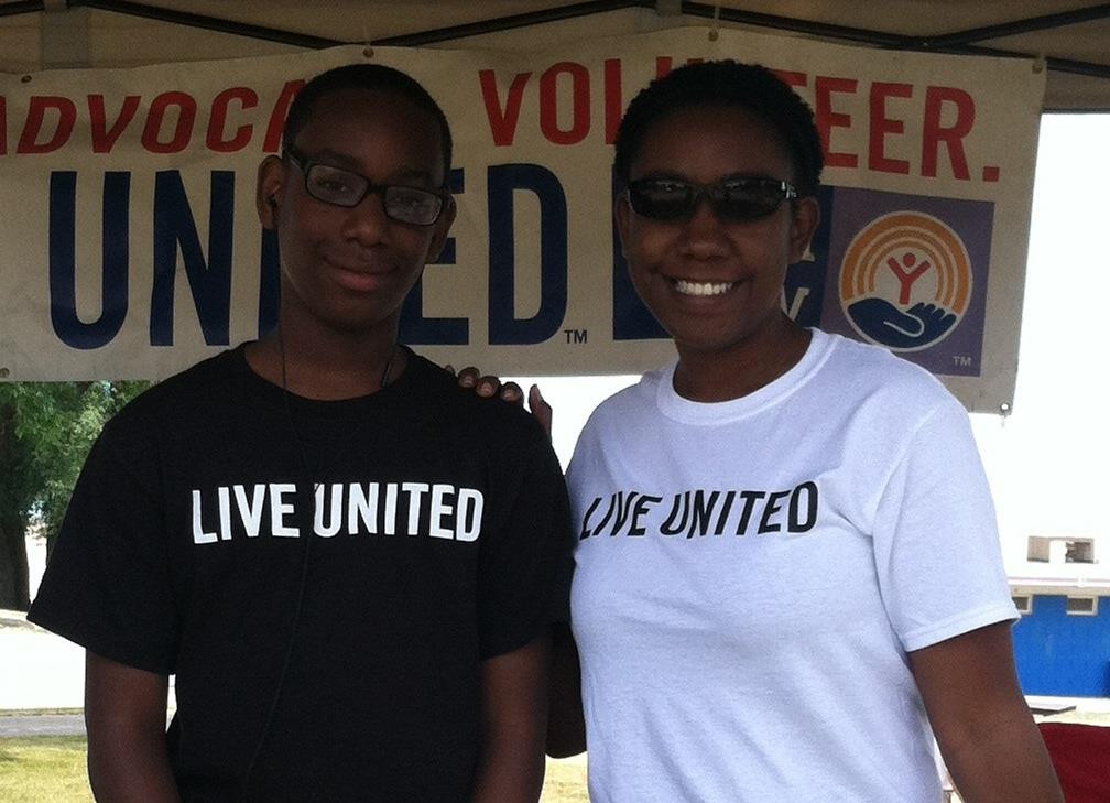 Angela and her son volunteering for United Way