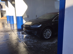 Tesla in Self wash bay