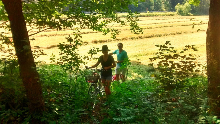 A couple enjoying private bicycle Ljubljan guided tour, green.