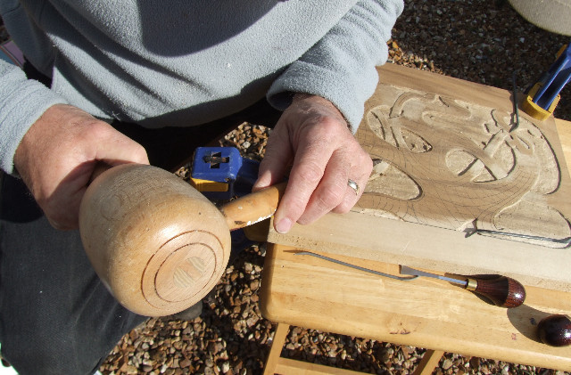 Ernie Allen carving the Longbook Cover