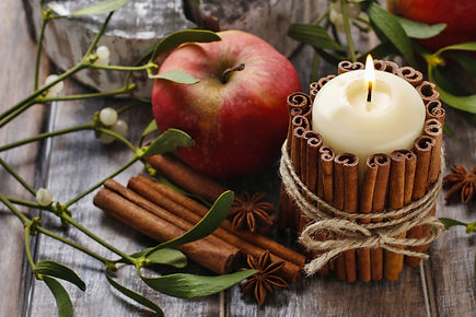 Candle decorated with cinnamon sticks and red apples, christmas decoration.jpg