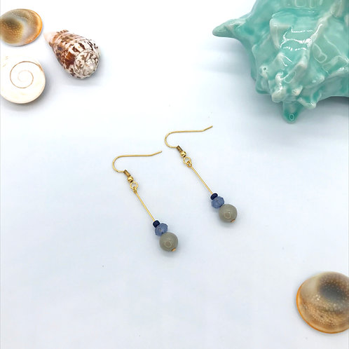 Boucles d'oreilles dorées - Les Rescapés
