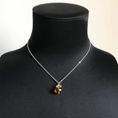 Collier argenté 2 perles. Transparent et Jaune