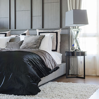modern bedroom design in black and white color scheme with modern lamp on side table