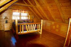 Log Cabin Loft Bedroom