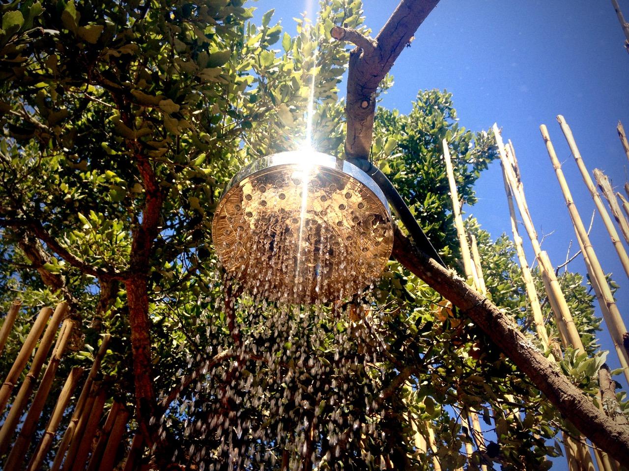 Sun heated outside shower