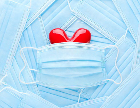 Bright%20red%20heart%20on%20a%20pile%20of%20medical%20face%20masks.%20Concept%20of%20support%2C%20lo