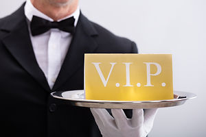 Close-up Of A Waiter Showing Vip Text Ba