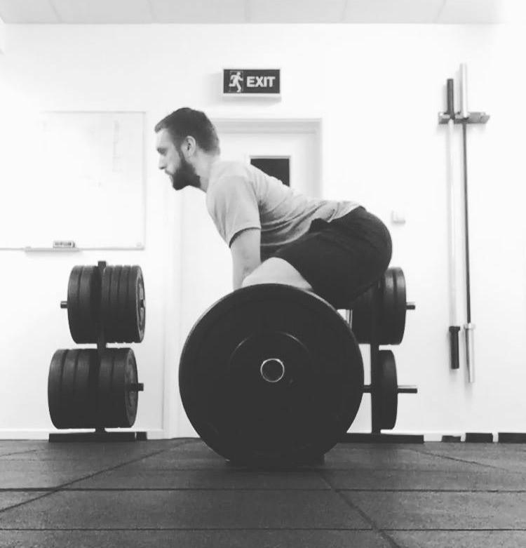 Overextended back position deadlift back pain