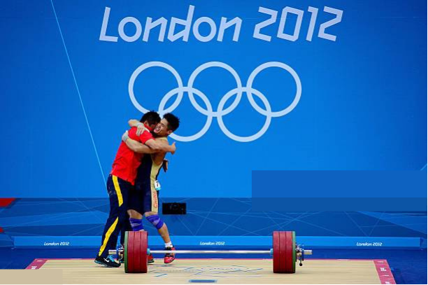 weightlifter hugging coach