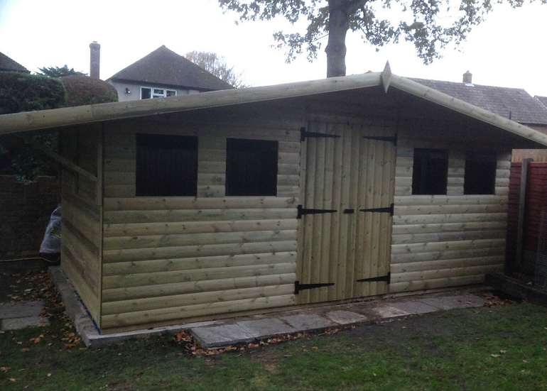 """16' x 10' TANALISED 19mm t&g loglap heavy duty shed with log shelter+18"""" canopy"""