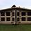 "Thumbnail: 16'x10' Tanalised 19mm t&g loglap heavy duty summerhouse reverse apex+18"" canopy"